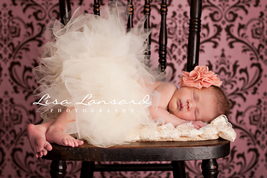Winnipeg newborn photographers christmas came early for miss cs parents isnt she just perfect she even gave us a little grin
